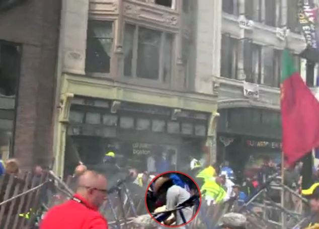 Seconds after the blast Mr Arredondo was pictured attending to victims