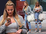 TOWIE star Georgia Kousoulou wearing a grey coat, cropped top, ripped jeans and wearing a pair of her boyfriend Tommy Mallet designer footwear out and about in London, UK. 10/06/2016..BYLINE MUST READ : JAMESY/GOTCHA IMAGES....Copyright by © Gotcha Images Ltd. All rights reserved...Usage of this image is conditional upon the acceptance ..of Gotcha Images Ltd, terms and conditions available at..www.gotchaimages.com
