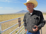 Cattle rancher John Ladd holds his new radio issued by the Cochise County Sheriff's Department for use in cases of emergency near Naco, Ariz., about 10 miles of it sits on the international border on Thursday, June 9, 2016. Ladd says drug smugglers frequently cross through his land and have burglarized his home on several occasions. The radios were handed out to about 30 border ranchers so they could have faster communication with 911 dispatchers. (AP Photo/Astrid Galvan)