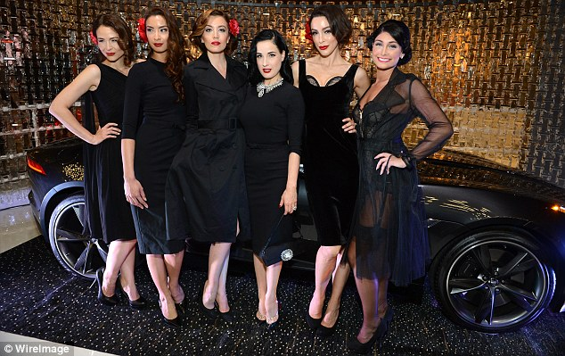 Picture perfect: Dita posed with the event's models in front of a Jaguar