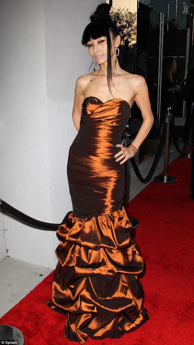 Amazing grace: Bai Ling packed her slender figure into a strapless copper gown with ruffled bottom