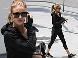 *EXCLUSIVE* Los Angeles, CA - Rosie Huntington-Whiteley wraps up a session at the gym. Rosie is carrying a restaurant style glass water bottle with a bail lid which seems like an odd choice for the gym. The 29-year-old model is wearing all black athletic wear paired with Nike sneakers. Rosie wears her blonde hair up in a ponytail as she heads out for the day. \nAKM-GSI          June 9, 2016\nTo License These Photos, Please Contact :\nMaria Buda\n(917) 242-1505\nmbuda@akmgsi.com\nsales@akmgsi.com\nor \nMark Satter\n(317) 691-9592\nmsatter@akmgsi.com\nsales@akmgsi.com\nwww.akmgsi.com