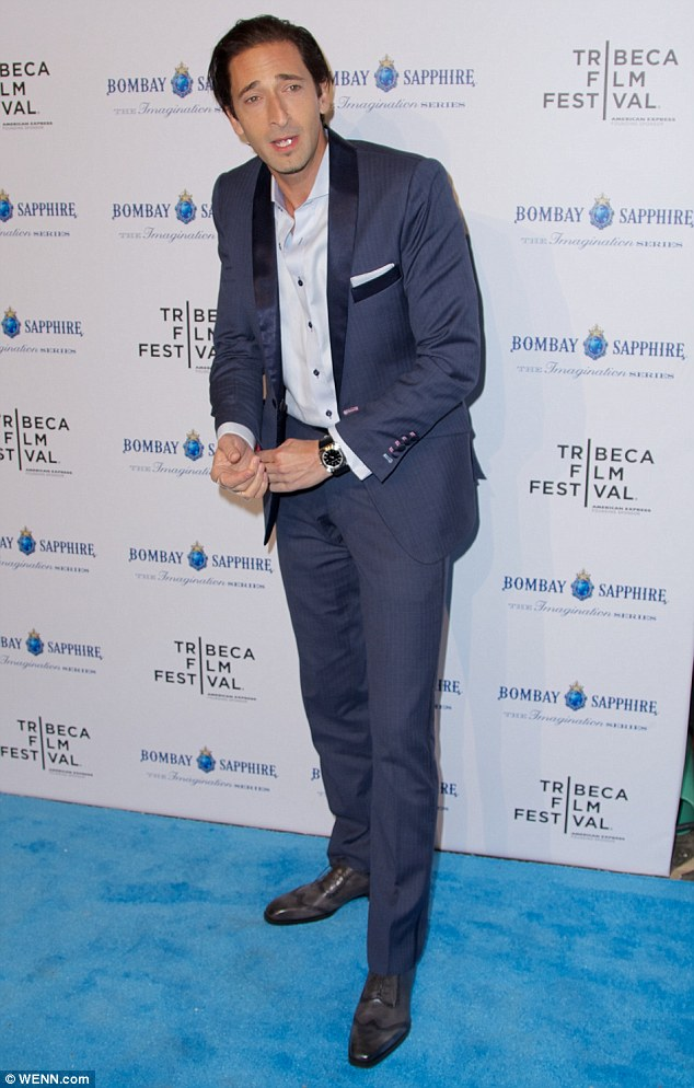 Retro: The 40-year-old actor dressed in a dapper suit that matched the blue carpet