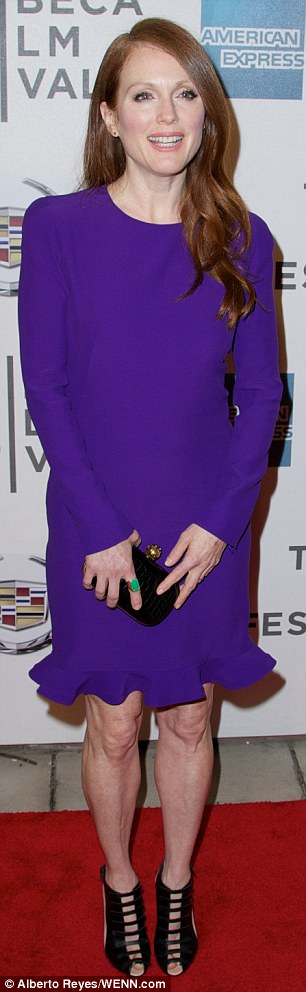 Impeccable style: The 52-year-old flaunted her slender figure in the frock, which sported a frilly lining and elegant long sleeves