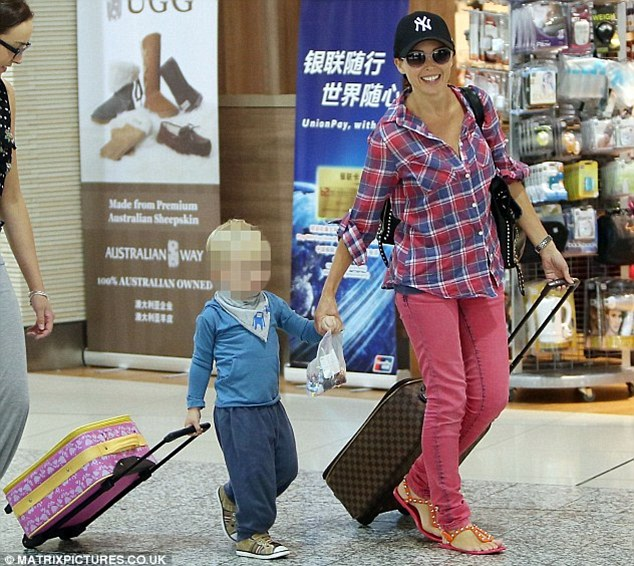 'I guess it's normal for me': The 41-year-old revealed that she is now accustomed to jetting all over the world with her two-year-old son Ethan