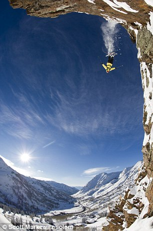 Swan dive: Extreme skier Julian Carr plunges from the sheer drop of a cliff face leaving a trail of snow