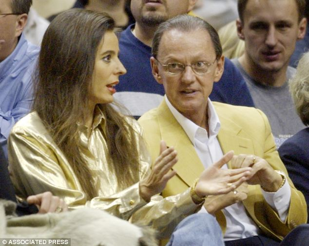 Lawsuit: Tomisue Hilbert, pictured with her husband Stephen in 2003, is suing his former business partner, billionaire John Menard, Jr., after he allegedly demanded sex from her