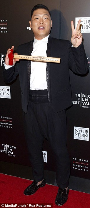 Bringing some fun: South Korean rapper Psy and Supersize Me's Morgan Spurlock attended the festival's Disruptive Innovation Awards at New York University on Friday