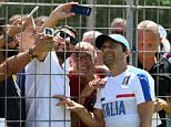 The Italy manager took selfies with fans before getting down to work with his 23-man squad in Montpellier