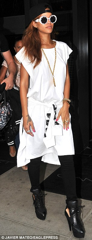 Stylish step: The singer was wearing a gold medallion around her neck which completed the theme