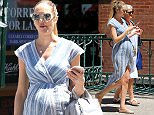 EXCLUSIVE: Pregnant model Candice Swanepoel, wearing a blue striped summer wrap dress and flats, and her mother Eileen Swanepoel head to lunch in New York City on Jun 10, 2016.  Pictured: Eileen Swanepoel,Candice Swanepoel Ref: SPL1299781  100616   EXCLUSIVE Picture by: Christopher Peterson/Splash News  Splash News and Pictures Los Angeles: 310-821-2666 New York: 212-619-2666 London: 870-934-2666 photodesk@splashnews.com