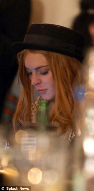 Lots to think about: At one point in the evening, Lindsay looked thoughtful as she scrolled through her phone