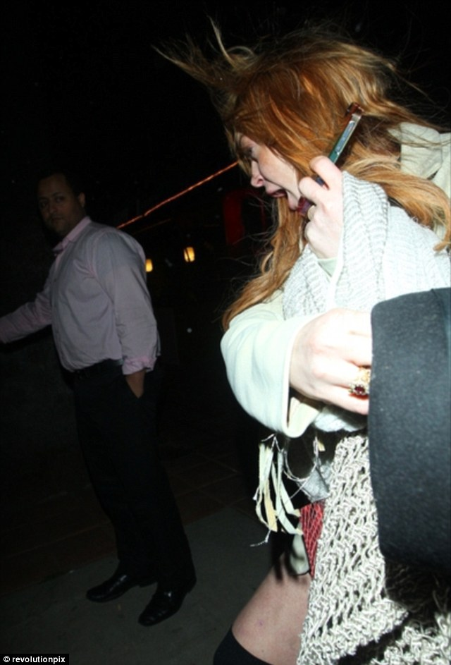 Not happy: Lindsay Lohan was not impressed to be caught out at a private members club in Santa Monica, California, on Saturday night