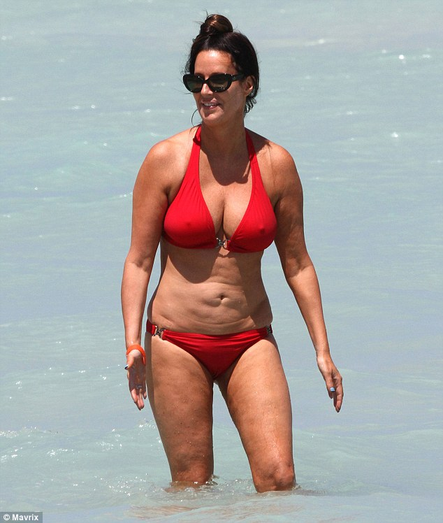 Bathing beauty: Patti Stanger soaked up the sunshine in Miami on Friday as she frolicked in the surf wearing a red bikini