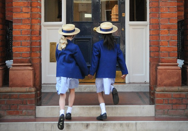 Young minds: Two pupils arrive for their lessons at Falkner House prep school in South Kensington, London