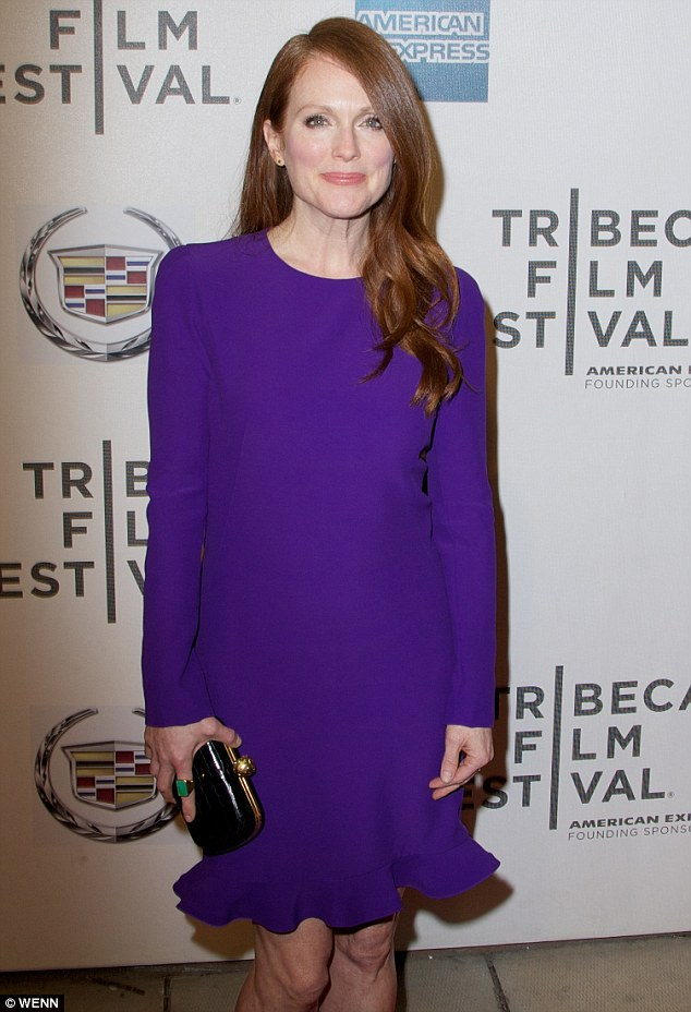 Flawless: Julianne Moore showed off her glowing complexion as she posed in a bright purple frock at the world premiere of her new film The English Teacher at the Tribeca Film Festival on Friday in Manhattan
