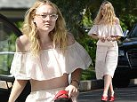 ***Not part of any subscription deal. Fee set at £150 before 22.00 HRS on 11th June 2016*** EXCLUSIVE ALLROUNDERDakota Fanning puts her shoes on as she leaves her car when she arrive at a friends house Featuring: Dakota Fanning Where: Los Angeles, California, United States When: 10 Jun 2016 Credit: WENN.com