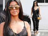 Kourtney Kardashian leaving the studio in a silk black suit and a ysl handbag as she films Keeping up with the Kardashians\n\nPictured: Kourtney Kardashian\nRef: SPL1299755  100616  \nPicture by: Clint Brewer / TC / Splash News\n\nSplash News and Pictures\nLos Angeles: 310-821-2666\nNew York: 212-619-2666\nLondon: 870-934-2666\nphotodesk@splashnews.com\n