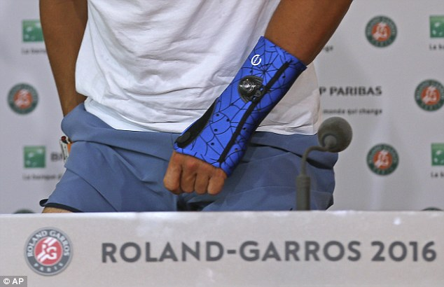 Nadal was wearing a protective blue sleeve that was meant to aid recovery but he had to withdraw