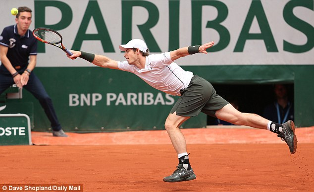 Murray stretches in vain to try and return a booming Karlovic serve during the Roland Garros encounter