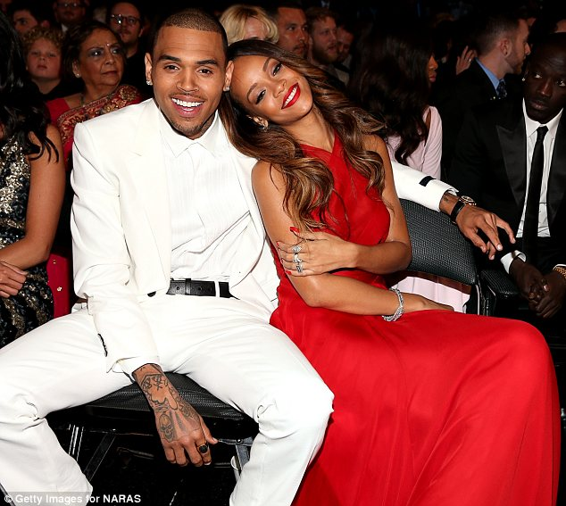 Still going strong: Chris has confirmed that he and Rihanna are still an item following rumours they had split
