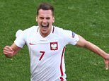 NICE, FRANCE - JUNE 12:  Arkadiusz Milik (C) of Poland celebrates scoring his team's first goal with his team mates Artur Jedrzejczyk (R) and Bartosz Kapustka (L) during the UEFA EURO 2016 Group C match between Poland and Northern Ireland at Allianz Riviera Stadium on June 12, 2016 in Nice, France.  (Photo by Alex Livesey/Getty Images)