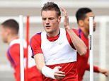 Vardy dodges between the poles out on the training pitch at the Stade du Bourgognes with his team-mates