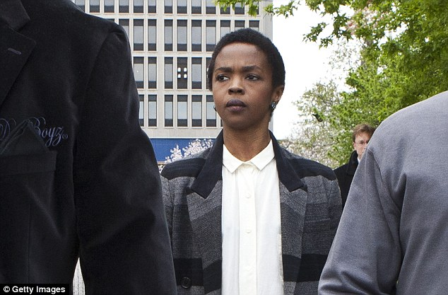Legal troubles: Hill is seen leaving court after the judge postponed her sentencing and gave her two weeks to pay back taxes April 22, 2013 in Newark, New Jersey