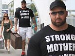 Picture Shows: Hafthor Julius Bjornsson  June 09, 2016\n \n 'Game Of Thrones' actor Hafthor Julius Bjornsson is spotted out shopping with his girlfriend in Beverly Hills, California. Bjornsson who plays The Mountain on the popular show was wearing a t-shirt that read 'Strong Mother F*#ker.\n \n Exclusive All Rounder\n UK RIGHTS ONLY\n Pictures by : FameFlynet UK © 2016\n Tel : +44 (0)20 3551 5049\n Email : info@fameflynet.uk.com