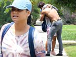 Please contact X17 before any use of these exclusive photos - x17@x17agency.com   Friday, June 10, 2016 - Christina Milian is seen smoking a cigarette and hugging a shirtless and shoeless mystery man as she arrives at a friend's home in the Hollywood Hills amid speculation she is rekindling her romance with Lil Wayne. Luis/X17online.com PREMIUM EXCLUSIVE