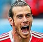 BORDEAUX, FRANCE - JUNE 11:  Gareth Bale of Wales celebrates scoring his team's first goal during the UEFA EURO 2016 Group B match between Wales and Slovakia at Stade Matmut Atlantique on June 11, 2016 in Bordeaux, France.  (Photo by Dean Mouhtaropoulos/Getty Images)