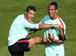 epa05353657 Portuguese national soccer team players Cristiano Ronaldo (L) and Bruno Alves (R) attend their team's training session in Marcoussis, France, 09 June 2016. The Portuguese team prepares for the UEFA EURO 2016 soccer championship that starts on 10 June 2016.  EPA/MIGUEL A. LOPES