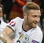 Germany's Shkodran Mustafi, right, celebrates after scoring the opening goal during the Euro 2016 Group C soccer match between Germany and Ukraine at the Pierre Mauroy stadium in Villeneuve díAscq, near Lille, France, Sunday, June 12, 2016. (AP Photo/Michael Probst)