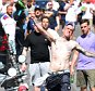 An England fan (C) throws a bottle towards police personnel as England fans gather in the  city of Marseille, southern France, on June 11, 2016, ahead of the Euro 2016 football match between England and Russia. / AFP PHOTO / LEON NEALLEON NEAL/AFP/Getty Images