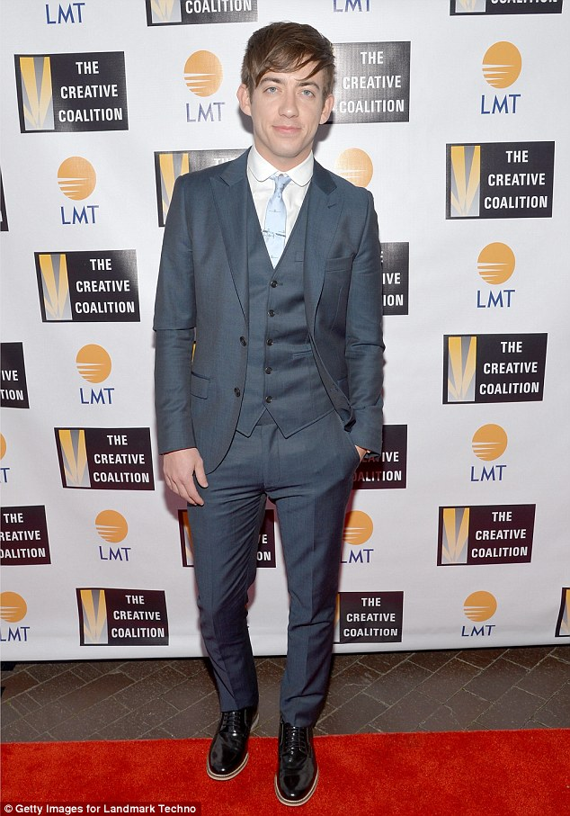 Musical star: Glee actor Kevin McHale looked smart in a grey suit and shiny black boots paired with a light blue tie