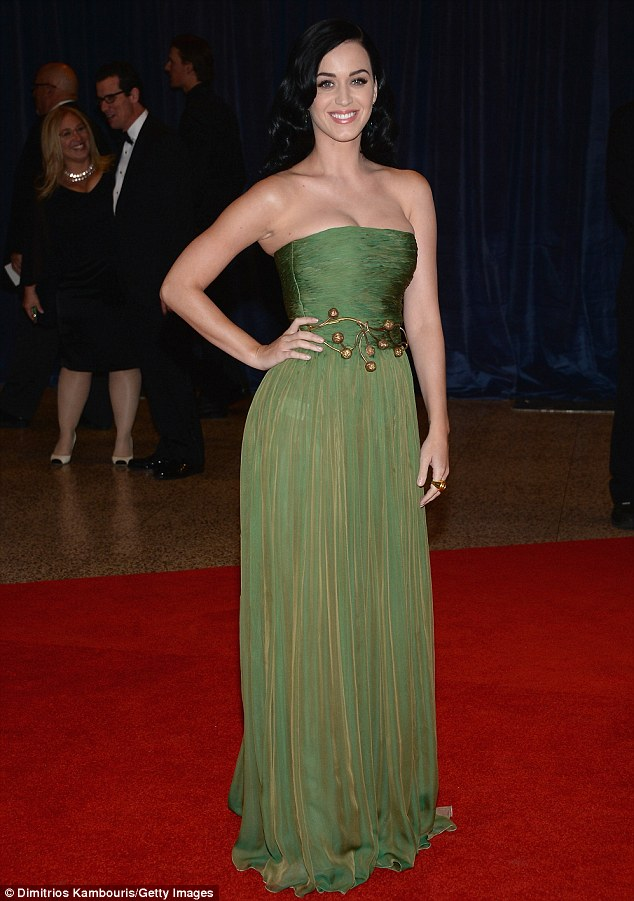 Parting the trees: Katy Perry dazzled the political intelligentsia in her strapless emerald gown at the White House Correspondents' Association Dinner in Washington, DC Saturday night