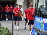 England's defender Chris Smalling (C) carries the team's Lion mascot as he leaves the team's hotel in Chantilly, on June 9, 2016 ahead of the Euro 2016 football tournament.  / AFP PHOTO / PAUL ELLISPAUL ELLIS/AFP/Getty Images