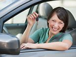 Woman with her car keys.    BEM81H  Image shot 2009. Exact date unknown.