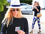 """Exclusive... 52088592 Actress Reese Witherspoon goes to a beauty salon in Los Angeles, California on June 10, 2016.  Afterwards, she did some light shopping. Reese left the beauty salon with a """"Beauty Bear"""" which is an age delay pillow. FameFlynet, Inc - Beverly Hills, CA, USA - +1 (310) 505-9876"""