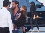 Please contact X17 before any use of these exclusive photos - x17@x17agency.com   Back together for good! Kourtney Kardashian and Scott Disick leave for the week end in a private jet with the kids X17online.com