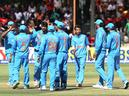 Indian players celebrate a wicket during the first ODI against Zimbabwe in Harare on Saturday.