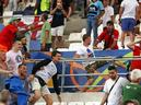 Russian supporters attack England fans at the end of the Euro 2016 Group B soccer match between England and Russia, at the Velodrome stadium in Marseille on Saturay.