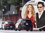 Police outside Amber Heard's downtown LA apartment amid claims Johnny Depp's people are removing items.\nAccording to TMZ, Amber's people called cops claiming Depp's people were violating the restraining order she has against him by removing items.\nThere was no suggestion Depp himself was at the scene.\n\nRef: SPL1295320  130616  \nPicture by: Splash News\n\nSplash News and Pictures\nLos Angeles: 310-821-2666\nNew York: 212-619-2666\nLondon: 870-934-2666\nphotodesk@splashnews.com\n