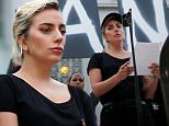 Singer Lady Gaga speaks at a vigil in memory of victims one day after a mass shooting at the Pulse gay nightclub in Orlando, outside City Hall in Los Angeles, California, U.S. June 13, 2016. REUTERS/Lucy Nicholson