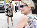 Beverly Hills, CA - Sharon Stone runs some errands on a sunny Beverly Hills day. The 58 year old looks great in a sleeveless graphic dress and green heels.\n  \nAKM-GSI       June 13, 2016\nTo License These Photos, Please Contact :\nMaria Buda\n(917) 242-1505\nmbuda@akmgsi.com\nsales@akmgsi.com\nMark Satter\n(317) 691-9592\nmsatter@akmgsi.com\nsales@akmgsi.com\nwww.akmgsi.com