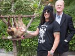 LOS ANGELES, CA - JUNE 11:  Slash (L) and Ed Bagley Jr.  pictured with Charlie Dalton Shenanigans the sloth at The Greater Los Angeles Zoo Association's 46th Annual Beastly Ball at Los Angeles Zoo on June 11, 2016 in Los Angeles, California.  (Photo by Gabriel Olsen/FilmMagic)
