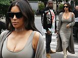 Kim Kardashian and Kanye West arrive in Paris  Pictured: Kim Kardashian and Kanye West Ref: SPL1301105  130616   Picture by: KCS Presse / Splash News  Splash News and Pictures Los Angeles: 310-821-2666 New York: 212-619-2666 London: 870-934-2666 photodesk@splashnews.com