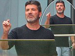 14.6.16..... Simon Cowell has a fag on the balcony of the pavillion at Lancashire County Cricket Ground on Tuesday afternoon and then flicks his fag over the balcony towards the pitch. The X Factor is filming it's Manchester auditions at the cricket ground for 2 days.
