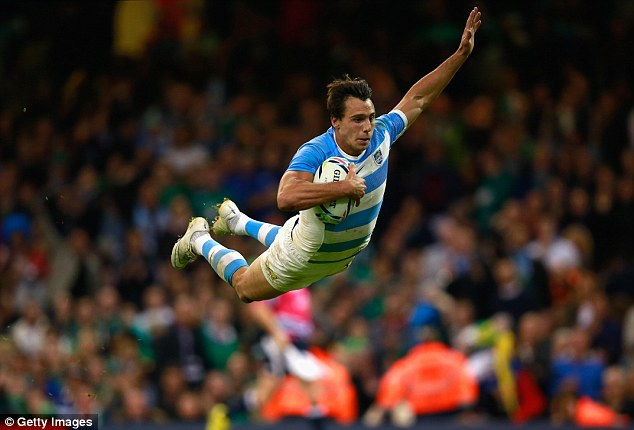 Juan Imhoff dives over for a try during Argentina's demolition of Ireland in the 2015 World Cup quarter-final