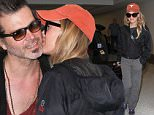 Los Angeles, CA - Renee Zellweger and boyfriend Doyle Bramhall II depart LAX together heading to Atlanta. The two show PDA as they make their way through the terminal. Renee keeps it casual wearing comfy pants and sneakers paired with a The North Face jacket and an orange cap. \n  \nAKM-GSI       June 14, 2016\nTo License These Photos, Please Contact :\nMaria Buda\n(917) 242-1505\nmbuda@akmgsi.com\nsales@akmgsi.com\nMark Satter\n(317) 691-9592\nmsatter@akmgsi.com\nsales@akmgsi.com\nwww.akmgsi.com